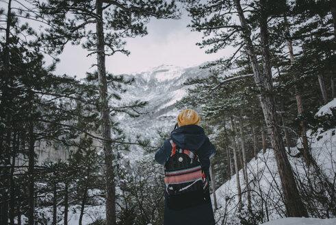 Caucasian woman admiring snowy forest - BLEF02995