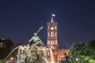 Germany, Berlin, view to lighted Red City Hall and Neptune fountain at night - TAMF01379