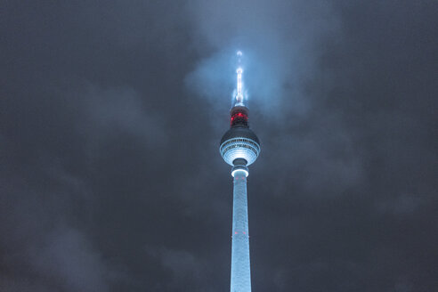 Germany, Berlin, illuminated television tower at night - TAMF01403