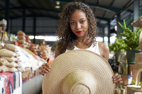 Portrait of woman with straw hat at market hall - VEGF00142