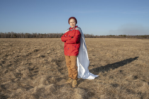Boy dressed up as superhero posing in steppe landscape - VPIF01229