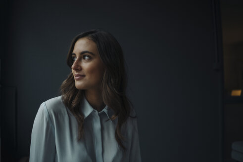 Portrait of smiling young businesswoman looking sideways - KNSF05766