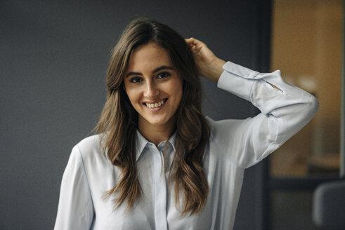 Portrait of happy young businesswoman - KNSF05787