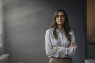 Portrait of young businesswoman looking sideways - KNSF05790