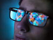 Biotechnology research, computer screen reflection in spectacles of new molecular formula in laboratory, close up of face - ISF21257