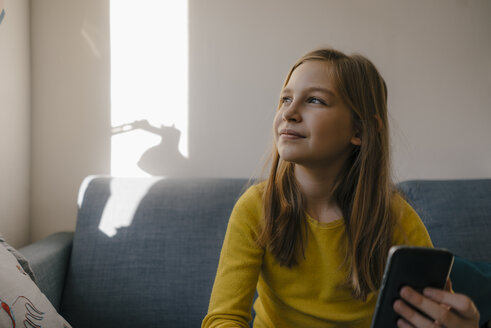 Girl on couch at home with cell phone - KNSF05829