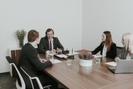 Business people having a meeting in conference room - AHSF00347