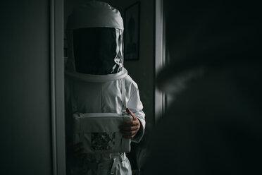 Astronaut staring into mirror - CUF50697
