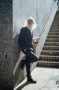 Senior businessman waiting near stairway, Milano, Lombardia, Italy - CUF50733