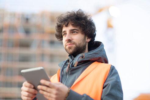 Man using digital tablet on street - CUF50943