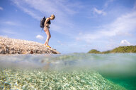 Woman exploring seaside, Ginto island, Linapacan, Philippines - CUF51009
