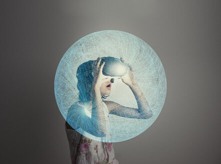 Mixed Race girl wearing virtual reality goggles in blue sphere - BLEF03089