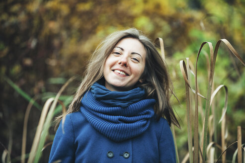 Smiling Caucasian woman wearing blue coat and scarf - BLEF03146