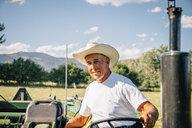 Portrait of Caucasian farmer on tractor - BLEF03203