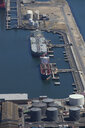 Aerial view of oil tanker moored at commercial dock - JUIF00926