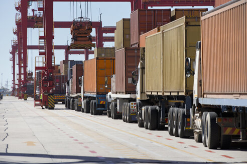 Lorries with cargo containers at commercial dock - JUIF01001