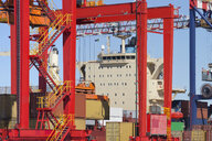 Crane lifting cargo container at commercial dock - JUIF01022