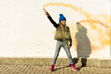 Happy girl with orange smoke torch - ERRF01287