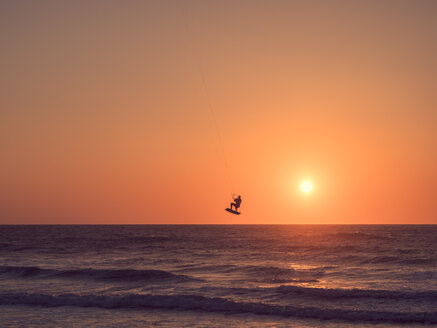 France, Conits Plage, kite surfer at sunset - LAF02315