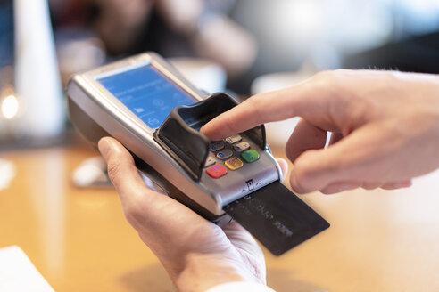 Man using credit card reader, close-up - DIGF07024