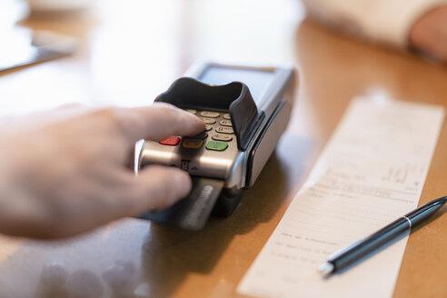 Man using credit card reader, close-up - DIGF07027