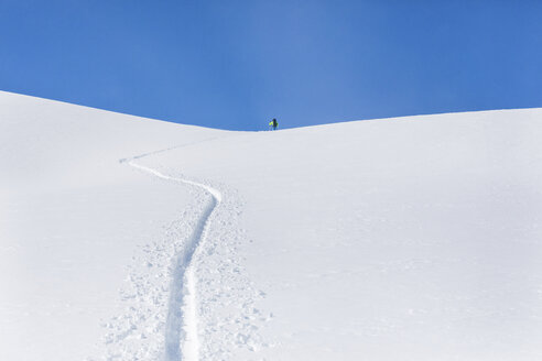 Austria, Tyrol, between Ischgl and Galtuer, Hohe Koepfe, ski tourer climbing up to the summit in winter - MMAF00937