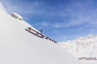 Austria, Tyrol, Galtuer, skier standing above an avalanche protection - MMAF00952