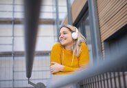 Happy young woman listening music with headphones - BFRF02010