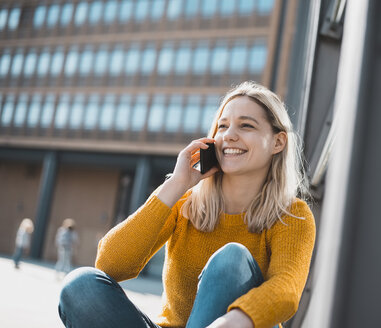 Portrait of happy young woman on the phone - BFRF02016