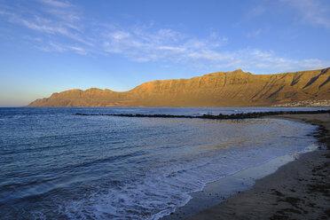 Spain, Canary Islands, Lanzarote, Caleta de Famara, Risco de Famara in the evening light - SIEF08631