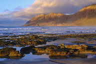 Spain, Canary Islands, Lanzarote, Caleta de Famara, beach and Risco de Famara in the background - SIEF08634