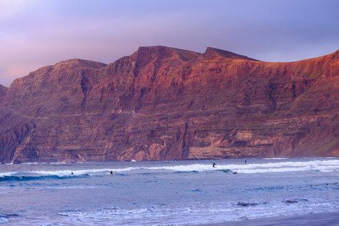 Spain, Canary Islands, Lanzarote, Caleta de Famara, Risco de Famara in the evening light - SIEF08637