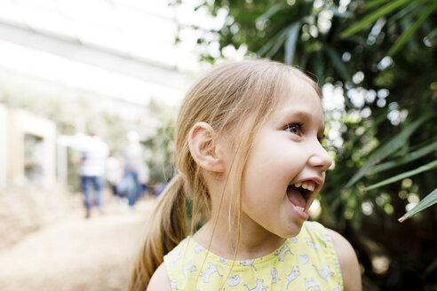 Portrait of happy girl outdoors - KMKF00942