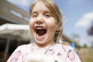 Portrait of happy girl outdoors - KMKF00948