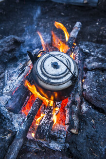 Boiling water pot over an open fire on a campsite on Tolbachik volcano, Kamchatka, Russia - RUNF02028