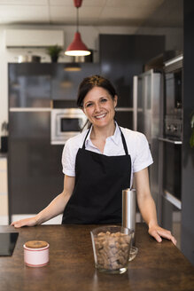 Portrait of a woman smiling looking at camera in a kitchen in Madrid, Spain - ABZF02380