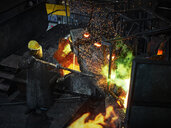 Industry, worker at furnace during melting copper, wearing a fire proximity suit - CVF01210