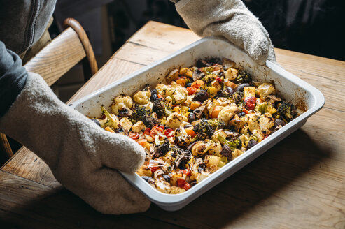 Baked vegetables with feta cheese in a baking pan, vegetarian side dish - IPF00519