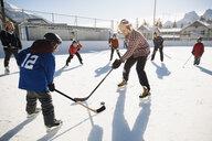 Community playing outdoor ice hockey - HEROF36212