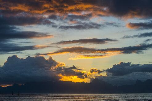 French Polynesia, Tahiti, dramatic sunset over Moorea - RUNF02071