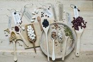 Variety of beans on wooden background - ASF06416