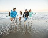 Smiling friends running on beach - BLEF03478
