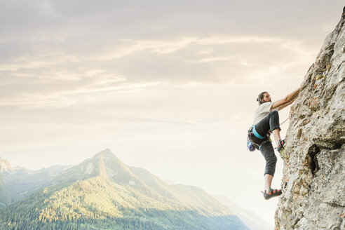 Caucasian man rock climbing - BLEF03592
