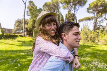 Romantic couple having fun in a park, Tuscany, Italy - MGIF00431