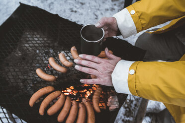 Close-up of woman having a winter barbecue - PSIF00270