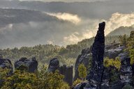 Germany, Saxony, Elbe Sandstone Mountains, rocks and rock needles of the Schrammsteine at backlight - RUEF02210