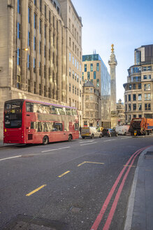 City of London, Liverpool street, financial district London with Monument to the Great Fire of London, city of London and red bus - TAMF01449