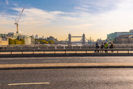 UK, London, people on a bridge with Tower Bridge in backgroungd - TAM01479
