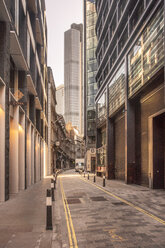 UK, London, narrow street in the City of London financial district with skyscrapers in the background - TAMF01482