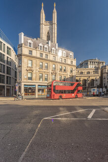 Queen victoria street, mansion house station at the City of London with a red bus - TAM01488